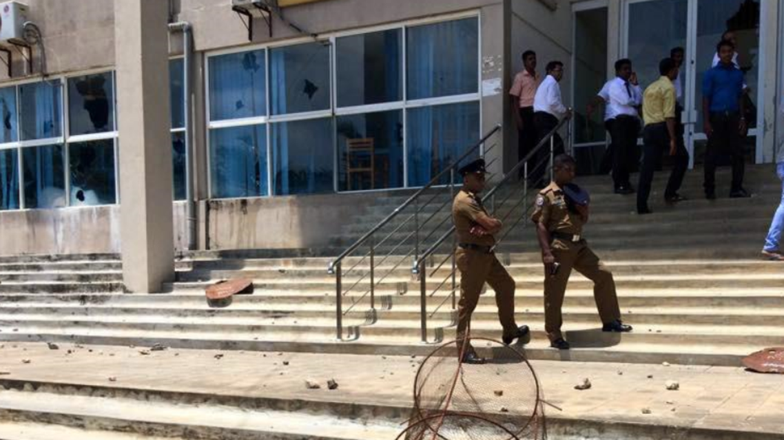 Sri Lanka police stand outside a court in Jaffna after violent protests shook the district (Photo courtesy of Twitter)