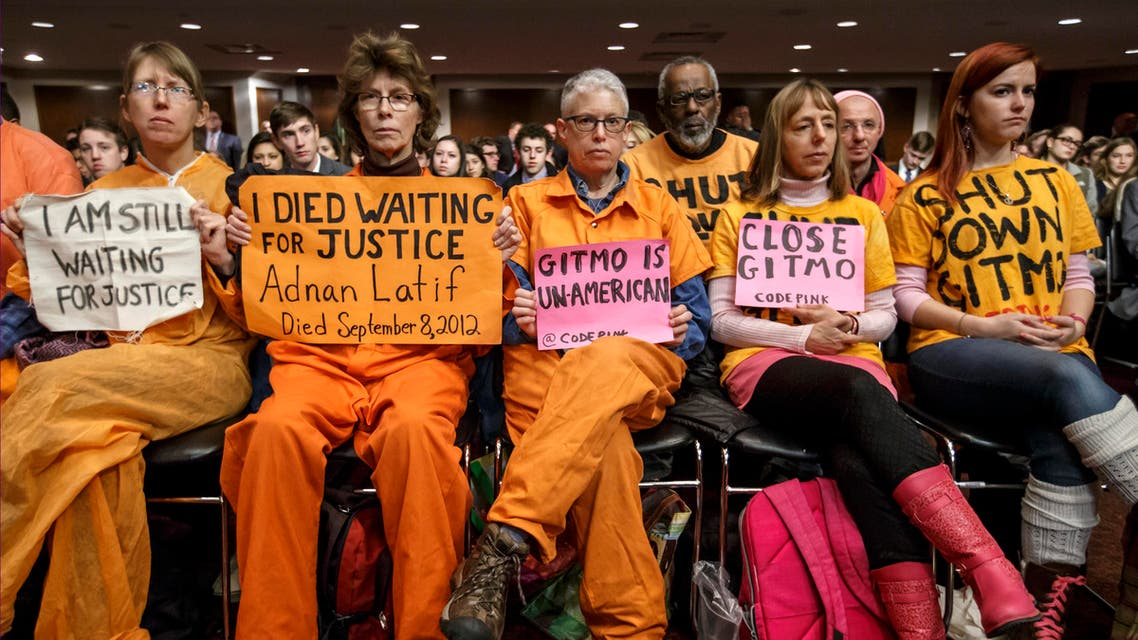 Activists from the antiwar group CodePink hold silent protest at the Senate Armed Services Committee during a hearing on the detention center in Guantanamo, Cuba, on Capitol Hill in Washington, Thursday, Feb. 5, 2015. AP