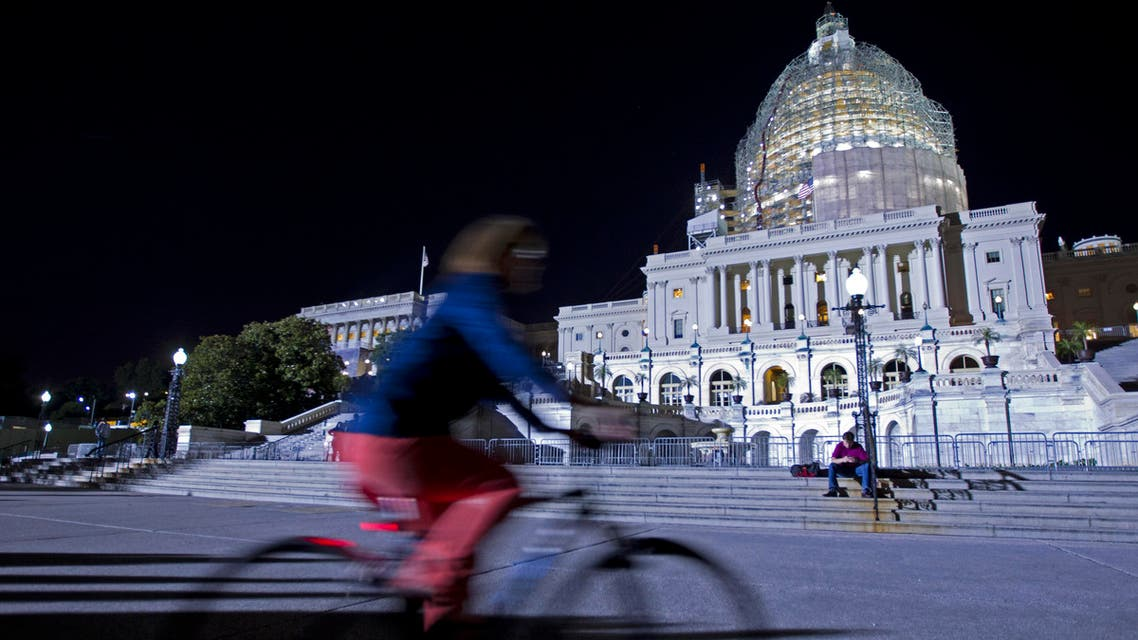 The U.S. Capitol is illuminated at night as the Senate continues to work late, Friday, May 22, 2015 on Capitol Hill as a pile of important bills await action. AP