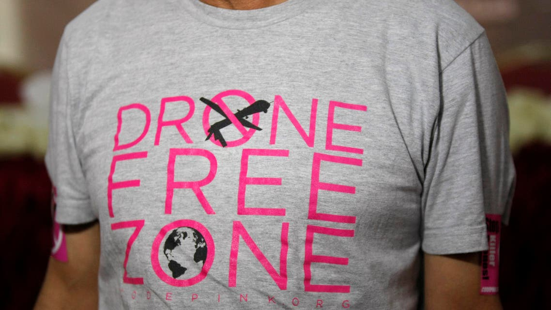 Faisal Ali Bin Jaber, a relative of victims of drone strikes, wears a shirt with anti-drone strike slogans as he attends the opening ceremony of the National Organization for the Victims of Drones in Sanaa, Yemen, Tuesday, April 1, 2014. (File: AP)