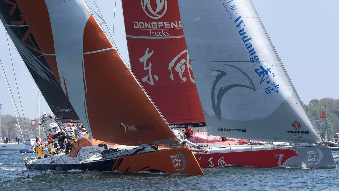 Team Alvimedica, left, and Team Dongfeng, right, racing yachts in the international Volvo Ocean Race, compete in Newport Harbor, Sunday, May 17, 2015, in Newport, R.I. The race departed Newport Sunday heading for Lisbon, Portugal, in the seventh leg of the global race. (AP)