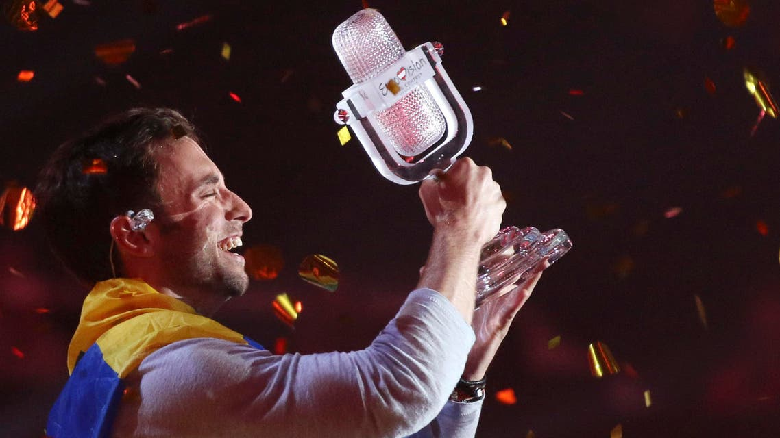 Mans Zelmerlow representing Sweden celebrates after winning the final of the Eurovision Song Contest in Austria's capital Vienna, Sunday, May 24, 2015. (AP Photo/Ronald Zak)