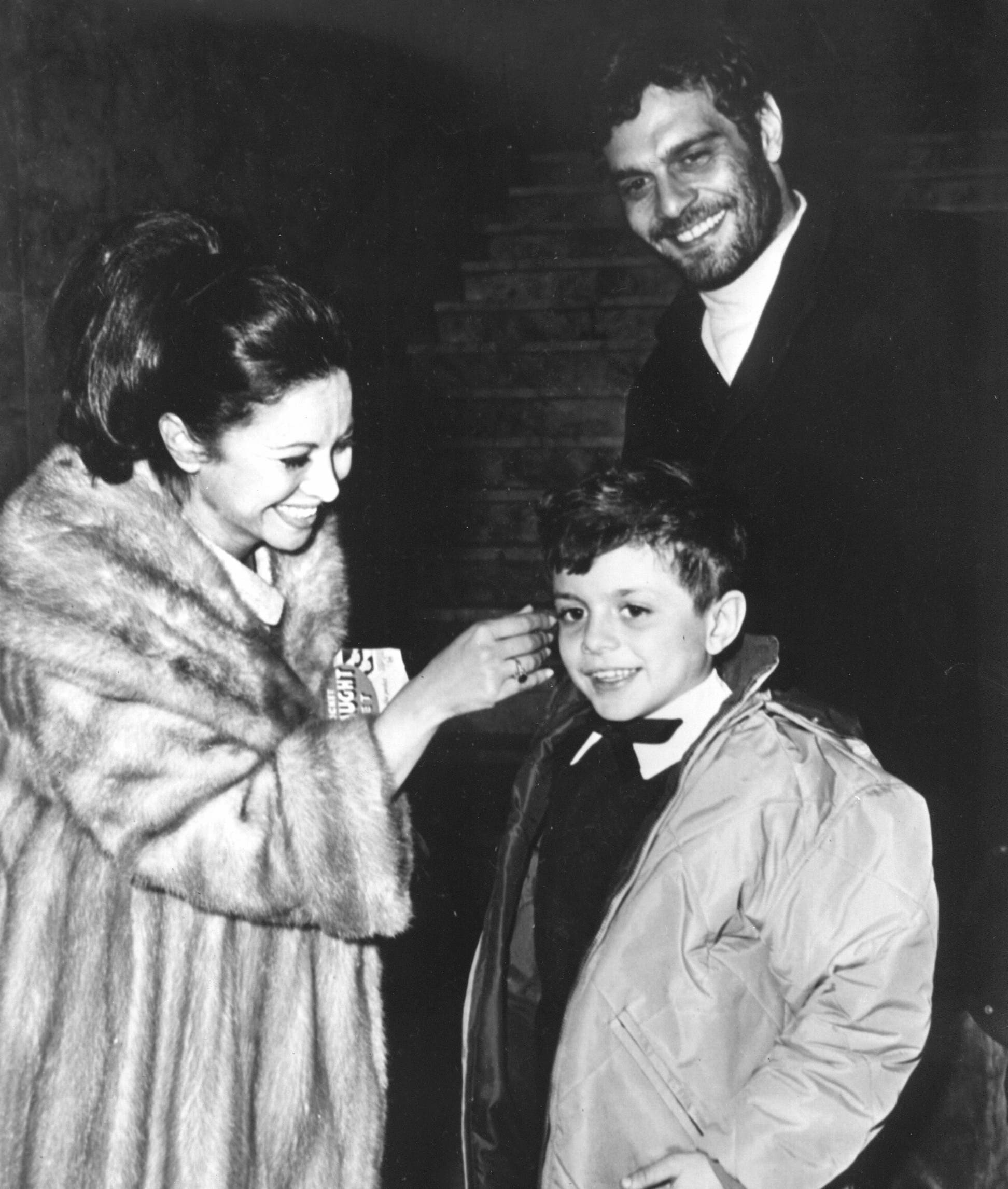 Egyptian actor Omar Sharif is seen with his wife, actress Faten Hamama, and their eight-year-old son, Tarek, as they get together for New Year's Eve celebration in Madrid, Spain, on Dec. 31, 1965. (File: AP)