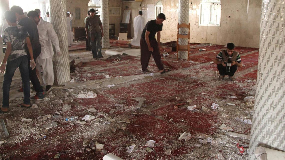 Police examine the debris after a suicide bomb attack at the Imam Ali mosque in the village of al-Qudaih. (Reuters)