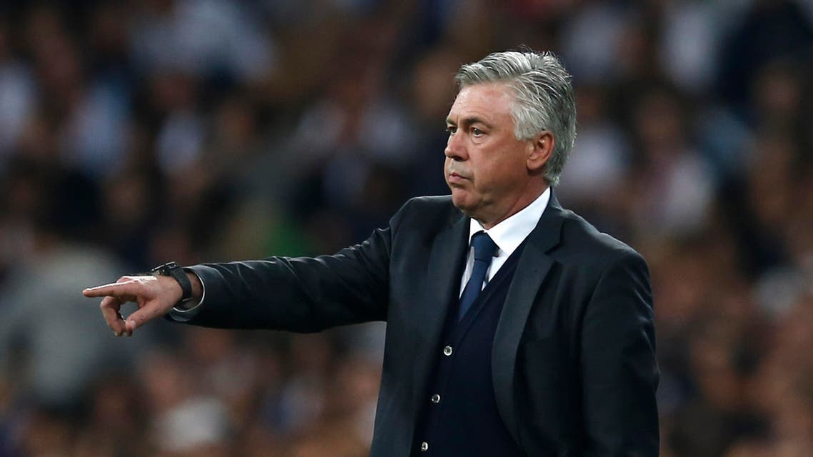 Real Madrid's coach Carlo Ancelotti gives directions to his players during the second leg quarterfinal Champions League soccer match between Real Madrid and Atletico Madrid at Santiago Bernabeu stadium in Madrid, Spain, Wednesday April 22, 2015. (AP)
