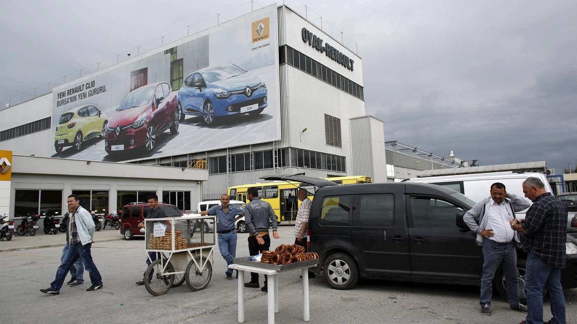 People stand in front of Renault car plant in Bursa, Turkey, pictured on May 21, 2015. (Reuters)