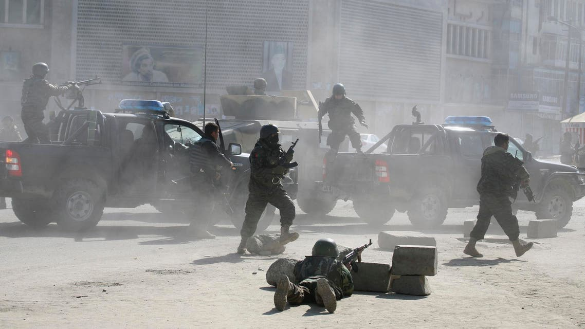 Afghan security forces run for the site of Afghan Justice Ministry following an attack in Kabul. (File: AP)