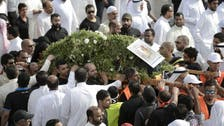 Saudis hold mass funeral for bombing victims