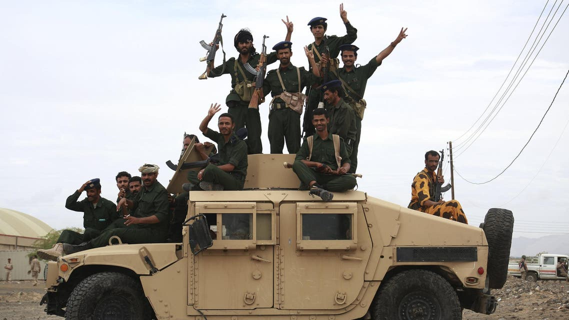 Soldiers loyal to Yemen's President Abd-Rabbu Mansour Hadi ride atop a military vehicle during a parade in Yemen's northern province of Marib May 25, 2015. REUTERS