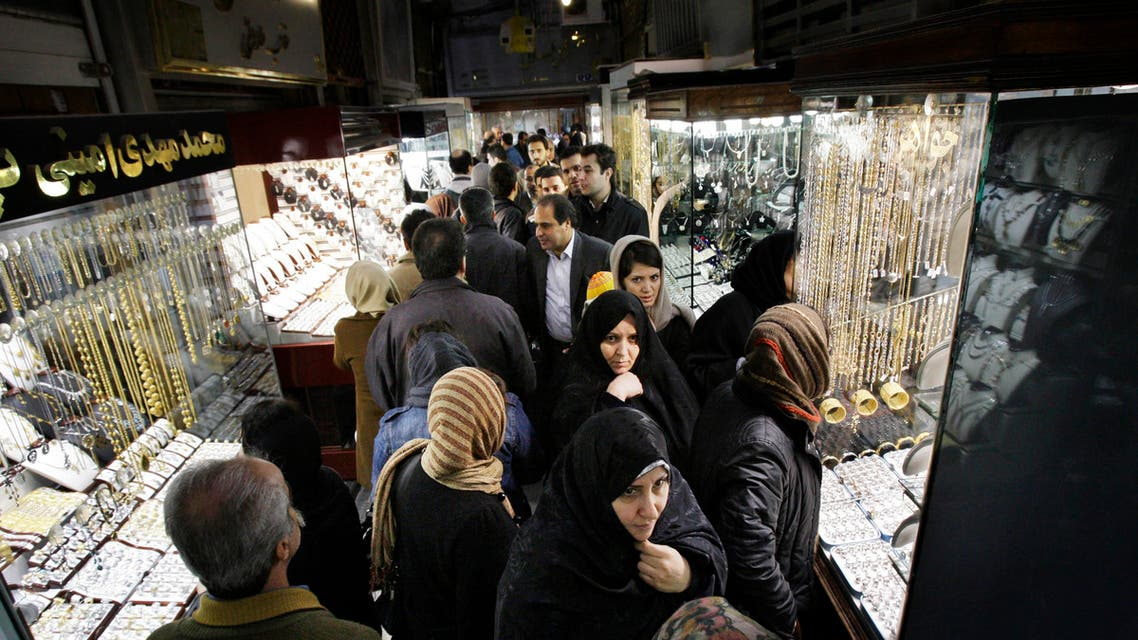 In this Thursday, Feb. 2, 2012 photo, Iranians walk at the gold market of Tehran's old main bazaar, Iran. A simple trip the store these days offers a crash course in life under sanctions. The price tags on many imported goods from South Korean refrigerators to Turkish crackers are sometimes double from last year. The money to buy them, meanwhile, has plunged in value against the U.S. dollar and other foreign currencies. (AP Photo/Vahid Salemi)