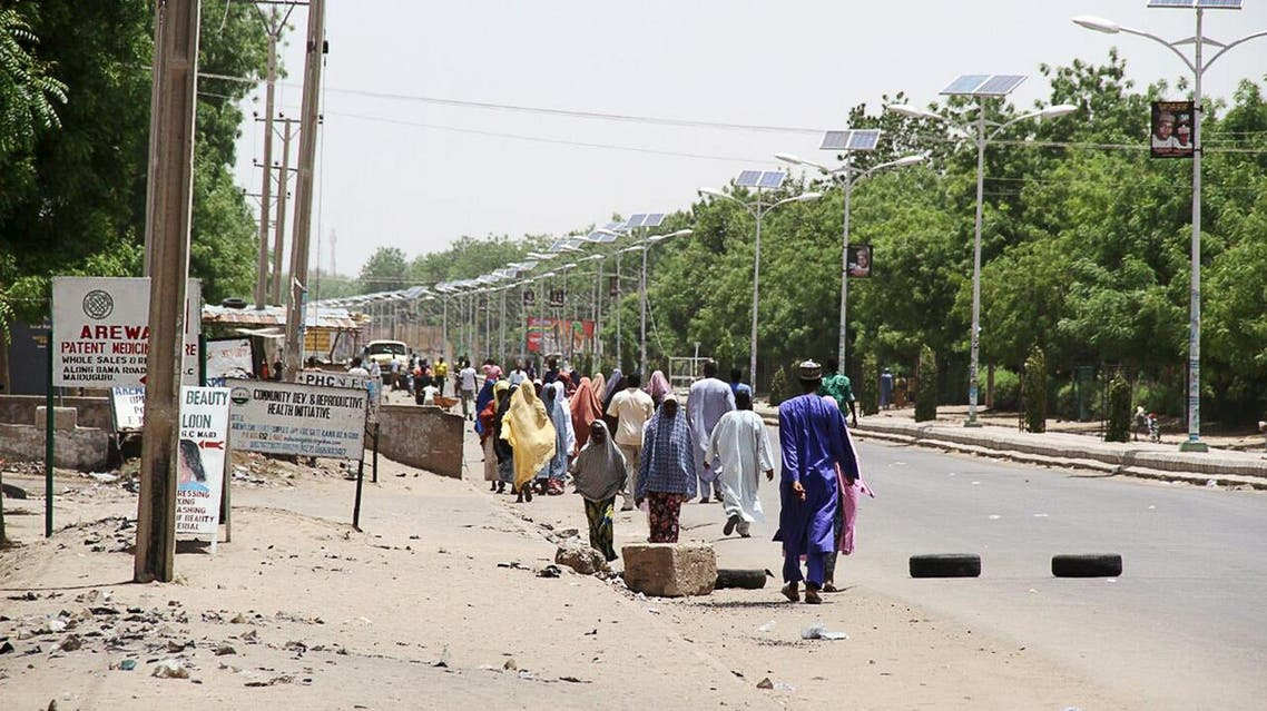 People walk along a road as they flee, in Maiduguri in Borno State, Nigeria May 14, 2015. Reuters