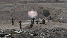 ISIS faces battle in Iraq, bombs in Syria