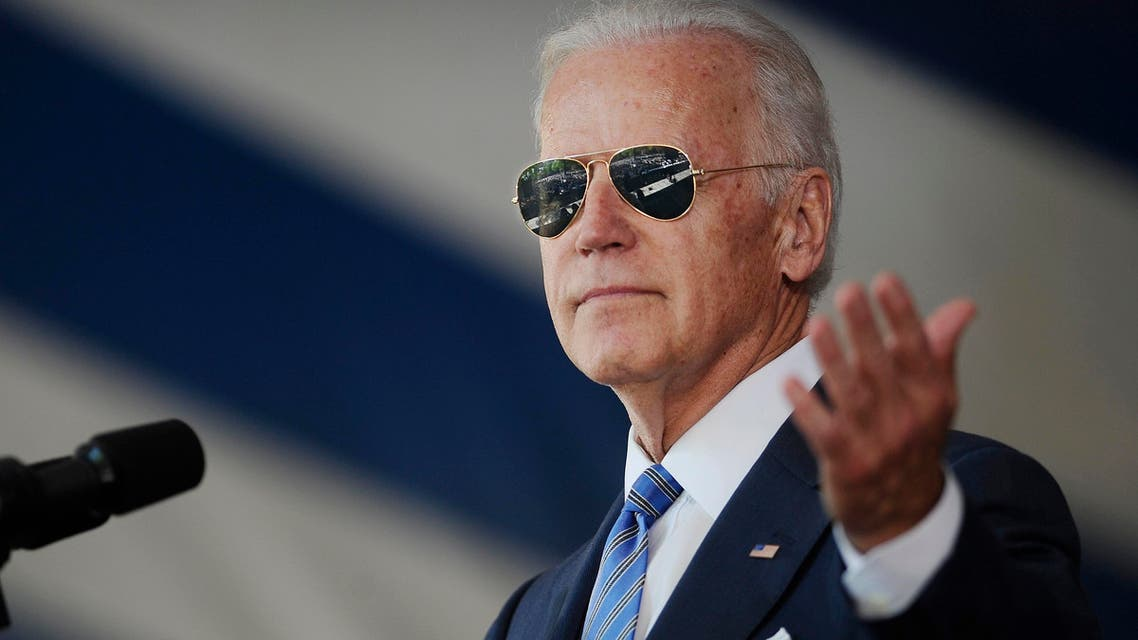 Vice President Joe Biden gestures after donning a pair of sunglasses as he delivers the Class Day Address at Yale University, Sunday, May 17, 2015, in New Haven, Conn. Biden urged graduating students to question the judgment of others, but not their motives to build consensus. (AP)