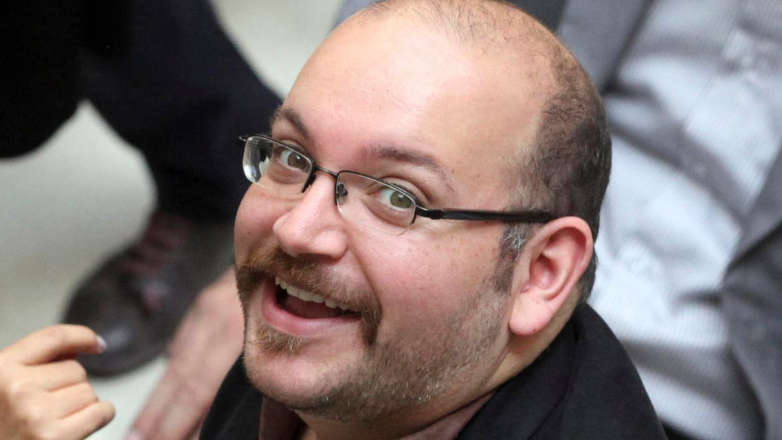 Jason Rezaian, an Iranian-American correspondent for the Washington Post, smiles as he attends a presidential campaign of President Hassan Rouhani in Tehran, Iran. (File Photo: AP)