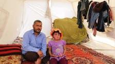 طفلة سورية تنتظر العلاج بعد أن حرقها برميل النظام