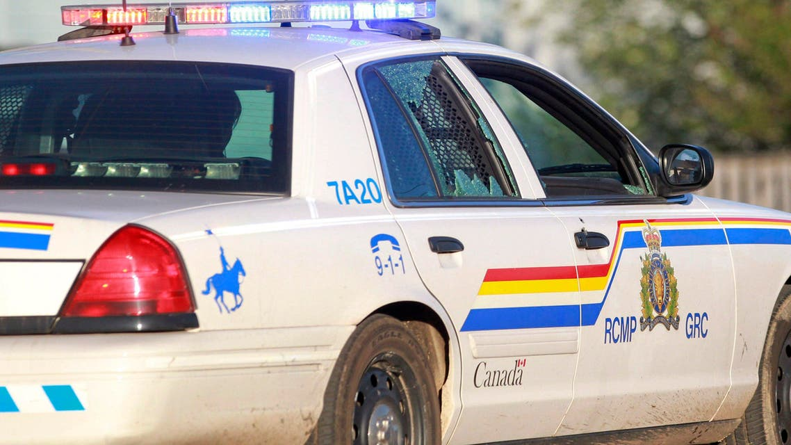 A Codiac Royal Canadian Mounted Police officer drives with the rear door window shattered by a bullet in Moncton, New Brunswick, on Wednesday, June 4, 2014. Three police officers were shot dead and two others injured Wednesday in the east coast Canadian province of New Brunswick, officials said, and authorities were searching for a suspect. The RCMP in New Brunswick confirmed on its Twitter feed that three officers were dead and two others had sustained non-life threatening injuries. (AP Photo/The Canadian Press, Viktor Pivovarov, Moncton Times & Transcript)