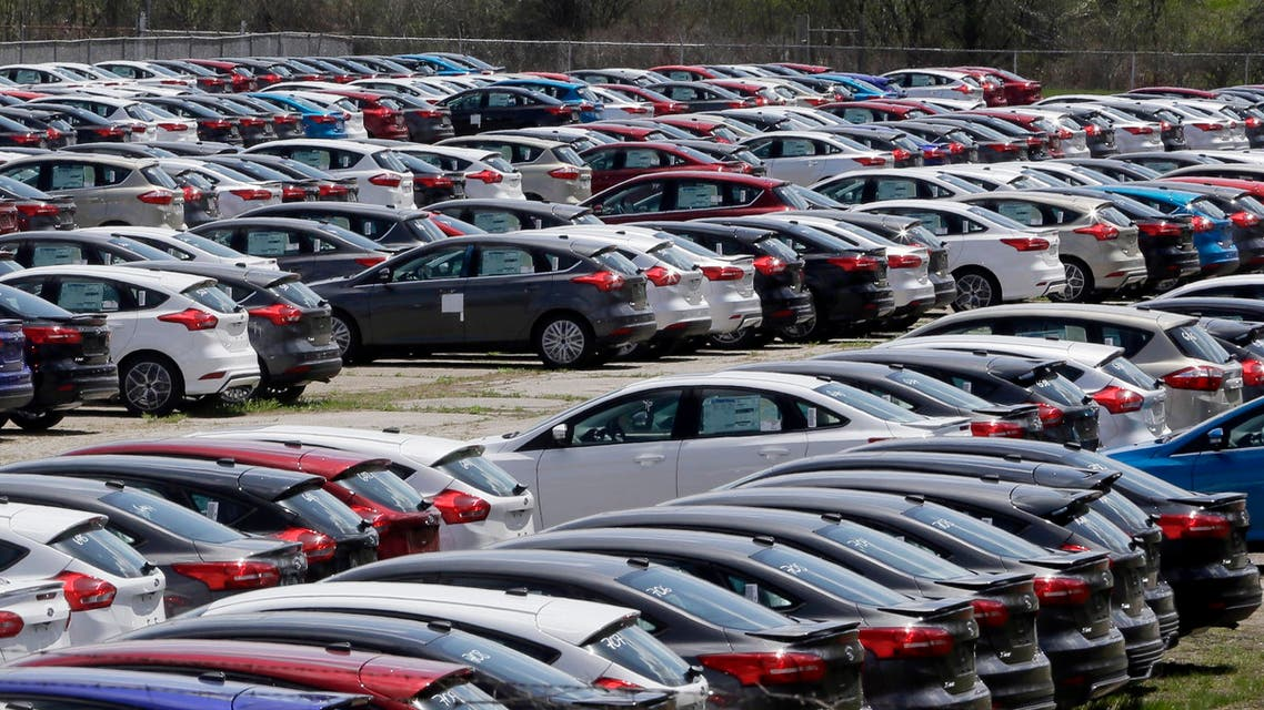 Ford Focus vehicles are seen on a storage lot on Friday, May 1, 2015 in Ypsilanti, Mich. Ford says its U.S. sales rose 5 percent last month for its best April in nine years. The Dearborn, Michigan, automaker sold more than 222,000 cars and trucks last month, led by small and midsize SUVs. (AP Photo/Carlos Osorio)