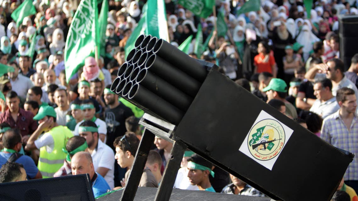 Palestinians show a rocket launcher during a celebration organized by Hamas in the West Bank city of Nablus, on Friday, Aug. 29, 2014. Israel and Hamas militants fought for 50 days before reaching a truce on Tuesday. Palestinian President Mahmoud Abbas has accused Hamas of needlessly extending fighting in the Gaza Strip, causing a high death toll. (AP Photo/Nasser Ishtayeh)