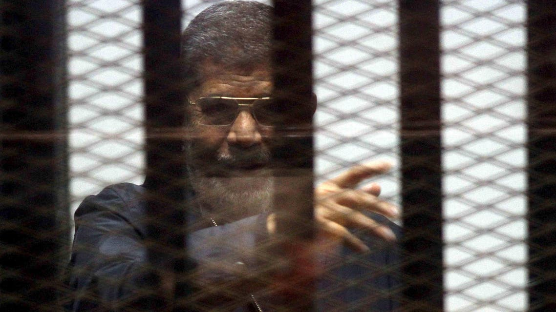 Ousted Egyptian President Mohamed Mursi is seen behind bars during his trial at a court in Cairo, April 30, 2015. (Reuters)