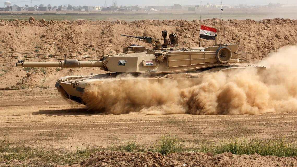 An Iraqi Army tank prepares to attack ISIS extremists in Tikrit, 130 kilometers north of Baghdad, March 13, 2015. (AP)