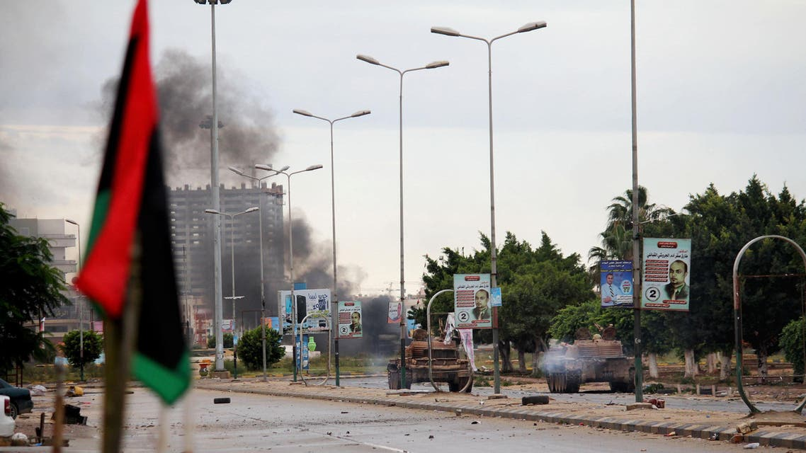 In this Wednesday, Oct. 29, 2014 photo, smoke rises during clashes between the Libyan military and Islamic militias in Benghazi, Libya. Government troops entered central Benghazi Wednesday after nearly 10 days of fighting Islamic extremist militias, a military spokesman said, in violence that killed dozens of people and forced