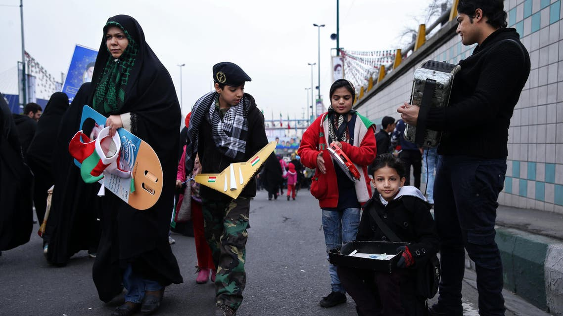 Iranian street musicians play music during a rally commemorating the 36th anniversary of Islamic Revolution under Azadi Tower, Tehran, Iran, Wednesday, Feb. 11, 2015. Iran marked the anniversary of its 1979 Islamic Revolution on Wednesday with massive rallies, with many chanting against the U.S. and Israel as the country tries to reach a permanent deal with world powers over its contested nuclear program. (AP Photo/Ebrahim Noroozi)