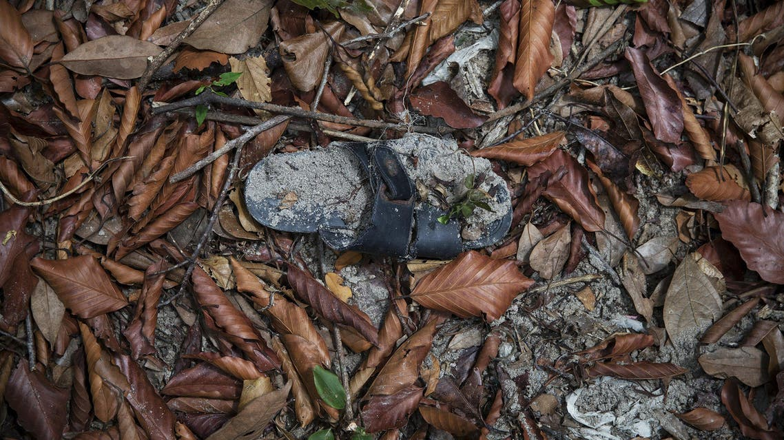 Clothes are photographed near abandoned human trafficking camp in the jungle close the Thailand border at Bukit Wang Burma in northern Malaysia May 26, 2015. (Reuters)