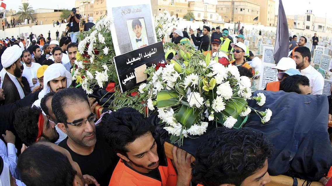 Shi'ite Muslims carry the coffin of a Saudi boy during a mass funeral for victims of last Friday's suicide attack on a mosque, in Qatif, east Saudi Arabia, May 25, 2015. Reuters