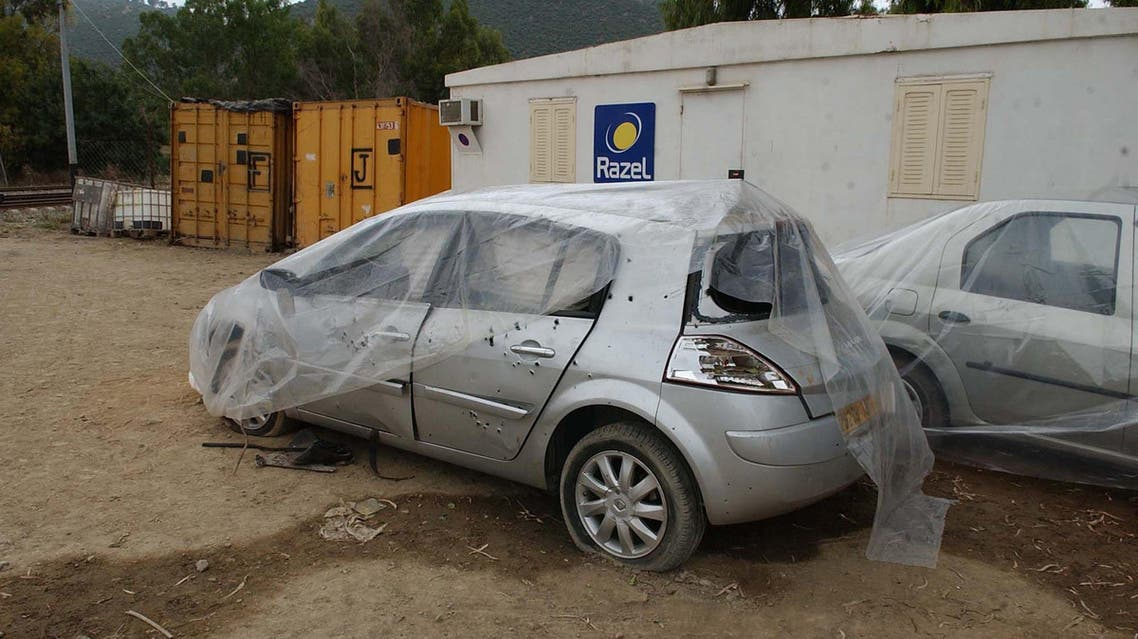 A car that was the target of a bombing, killing a French engineer working on a renovation project for a French enterprise is seen under a plastic cover in the town of Beni Amrane, Algeria, Monday, June 9, 2008. AP
