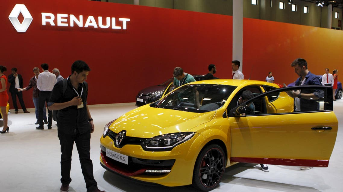 Visitors look at cars displayed on the stand of French carmaker Renault at the Istanbul Motor Show, pictured in May 2015. (File photo: Reuters)