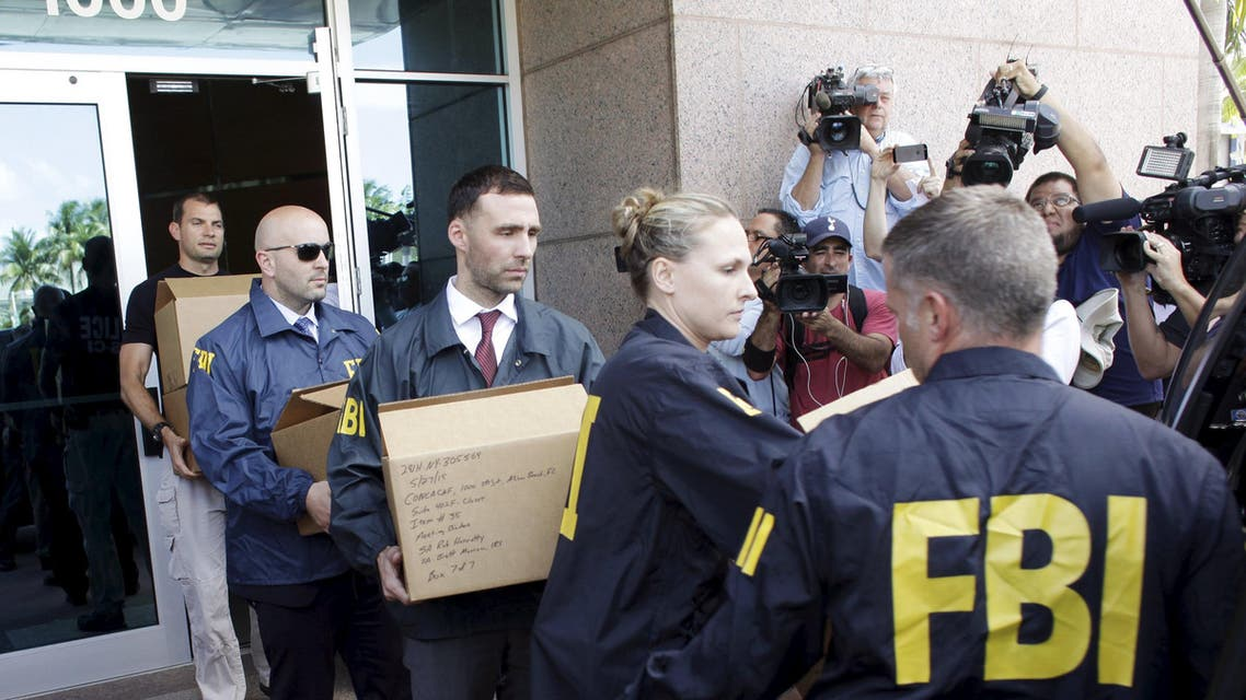 FBI agents bring out boxes after an operation inside the CONCACAF (Confederation of North, Central America and Caribbean Association Football) offices in Miami Beach, Florida May 27, 2015. (Reuters)
