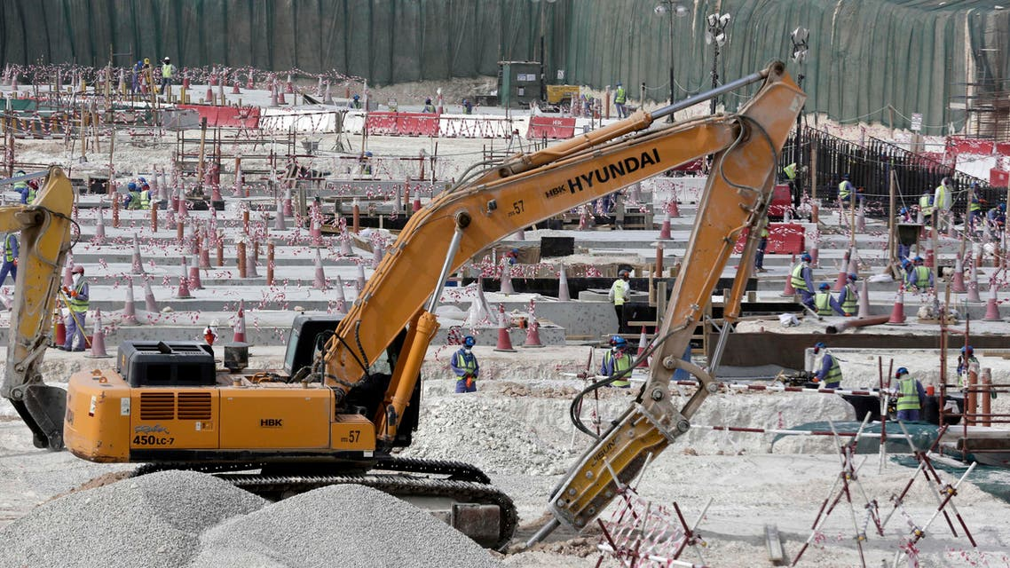 In this Monday, May 4, 2015 file photo taken during a government organized media tour, workers use heavy machinery at the Al-Wakra Stadium being built for the 2022 World Cup, in Doha, Qatar. (AP)