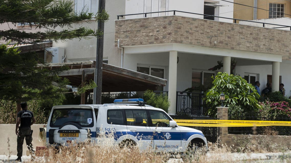 Cypriot police cordon off the house of a Lebanese man holding a Canadian passport in the Cypriot coastal city of Larnaca where more than 400 boxes of ammonium nitrate -- a fertiliser that when mixed with other substances can be used to make explosives -- was discovered, on May 28, 2015. AFP
