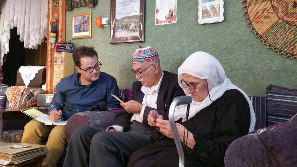 Researcher from the Palestinian Museum sitting with the Jamal Yousef Bek Ali family.