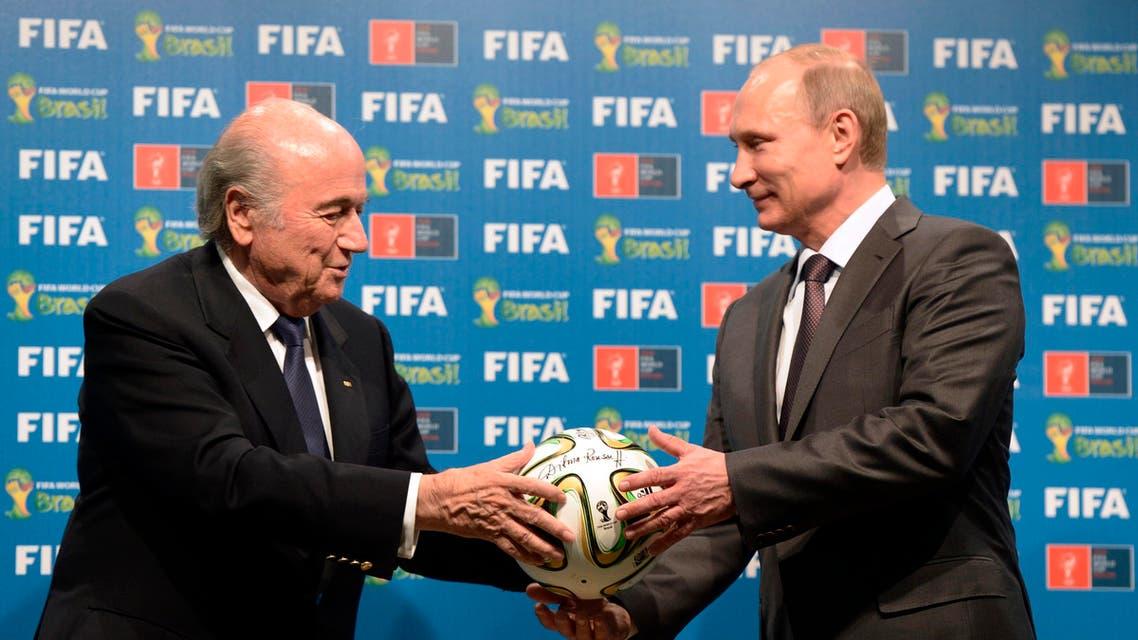 n this file photo taken on Sunday, July 13, 2014, FIFA President Sepp Blatter, left, and Russian President Vladimir Putin hold a soccer ball - AP