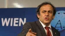 Platini says he wants to tone down politics at FIFA