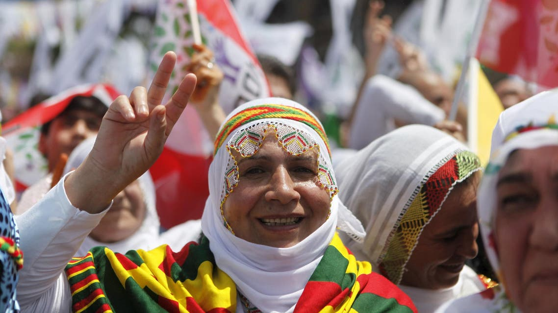 Supporters of Selahattin Demirtas, co-chairman of the pro-Kurdish Peoples' Democracy Party (HDP), attend an election rally for Turkey's June 7 parliamentary elections in Istanbul, Turkey May 24, 2015. REUTERS