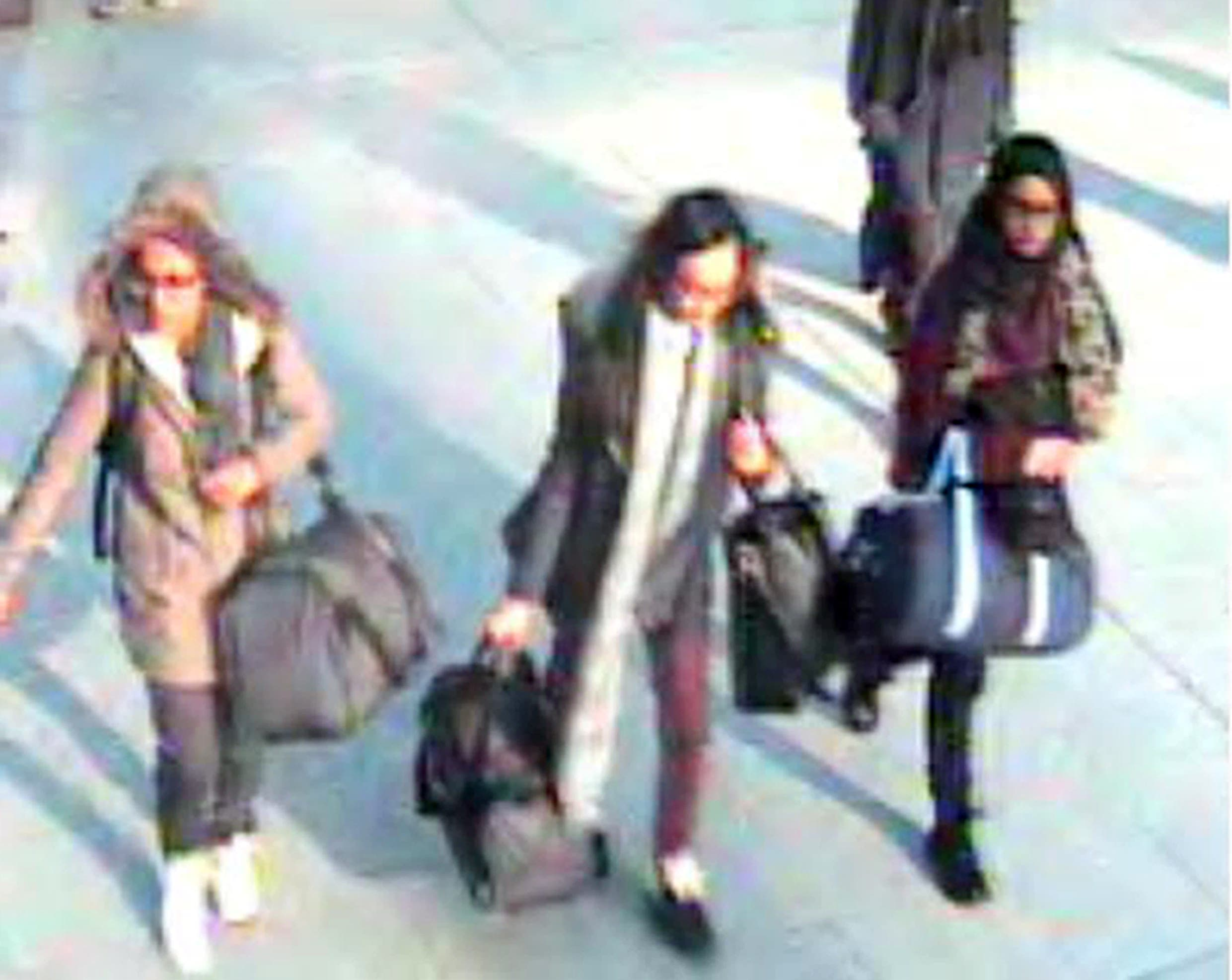 In this still taken from CCTV issued by the Metropolitan Police in London on Feb. 23, 2015, 15-year-old Amira Abase, left, Kadiza Sultana,16, center, and Shamima Begum, 15, walk through Gatwick airport, south of London, before catching their flight to Turkey on Tuesday Feb 17, 2015. (AP)