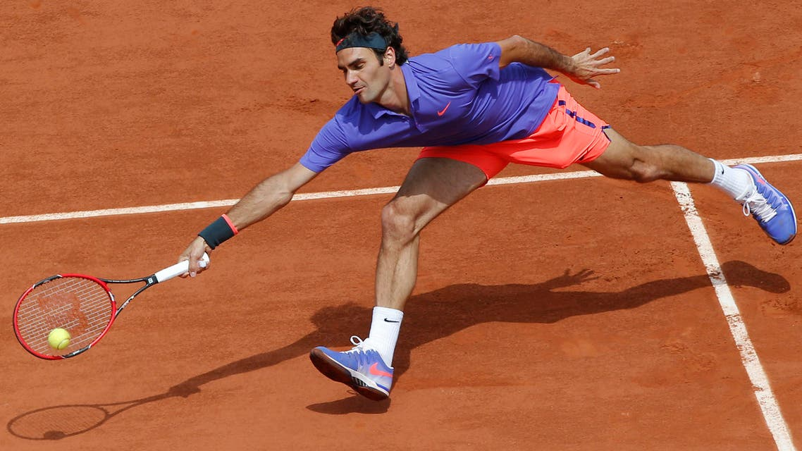 Switzerland's Roger Federer returns in the third round match of the French Open tennis tournament against Bosnia and Herzegovina's Damir Dzumhur at the Roland Garros stadium, in Paris, France, Friday, May 29, 2015.  (AP)
