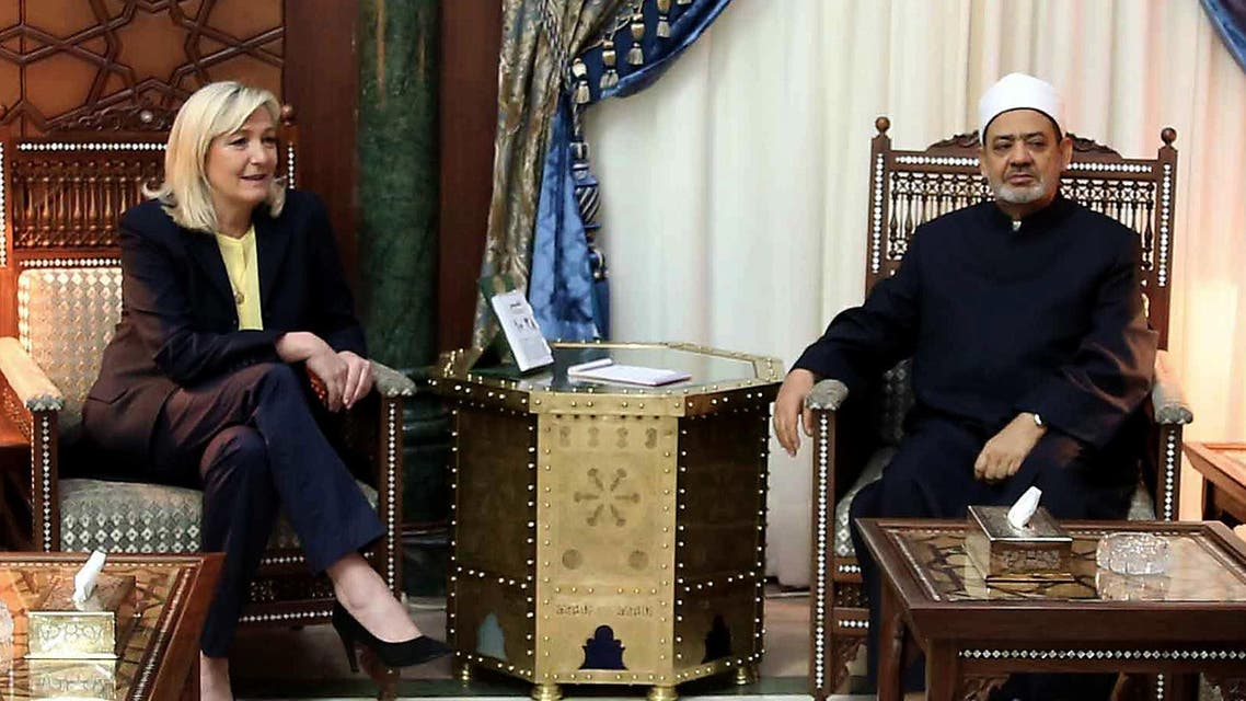 Egyptian grand Imam of al-Azhar Sheikh Ahmed el-Tayeb (R) meets with the leader of the French far-right Front National party Marine Le Pen (L), in al-Azhar headquarters in Cairo on May 28, 2015. AFP