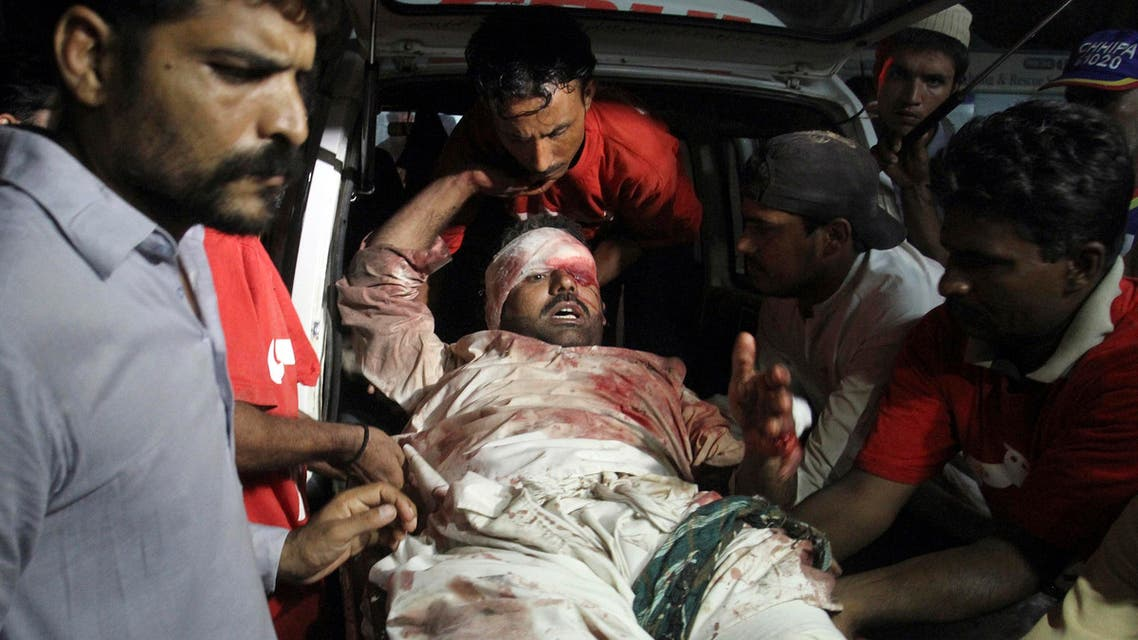 Pakistani volunteers and rescue workers unload an injured victim of a bomb blast upon his arrival at a local hospital in Karachi, Pakistan Sunday, May 24, 2015. Police say the son of Pakistan's president has escaped a roadside bomb attack unharmed after the blast killed three people and wounded 15. The attack happened late Sunday in Pakistan's restive Baluchistan province, long home to a low-intensity insurgency. (AP Photo/Fareed Khan)