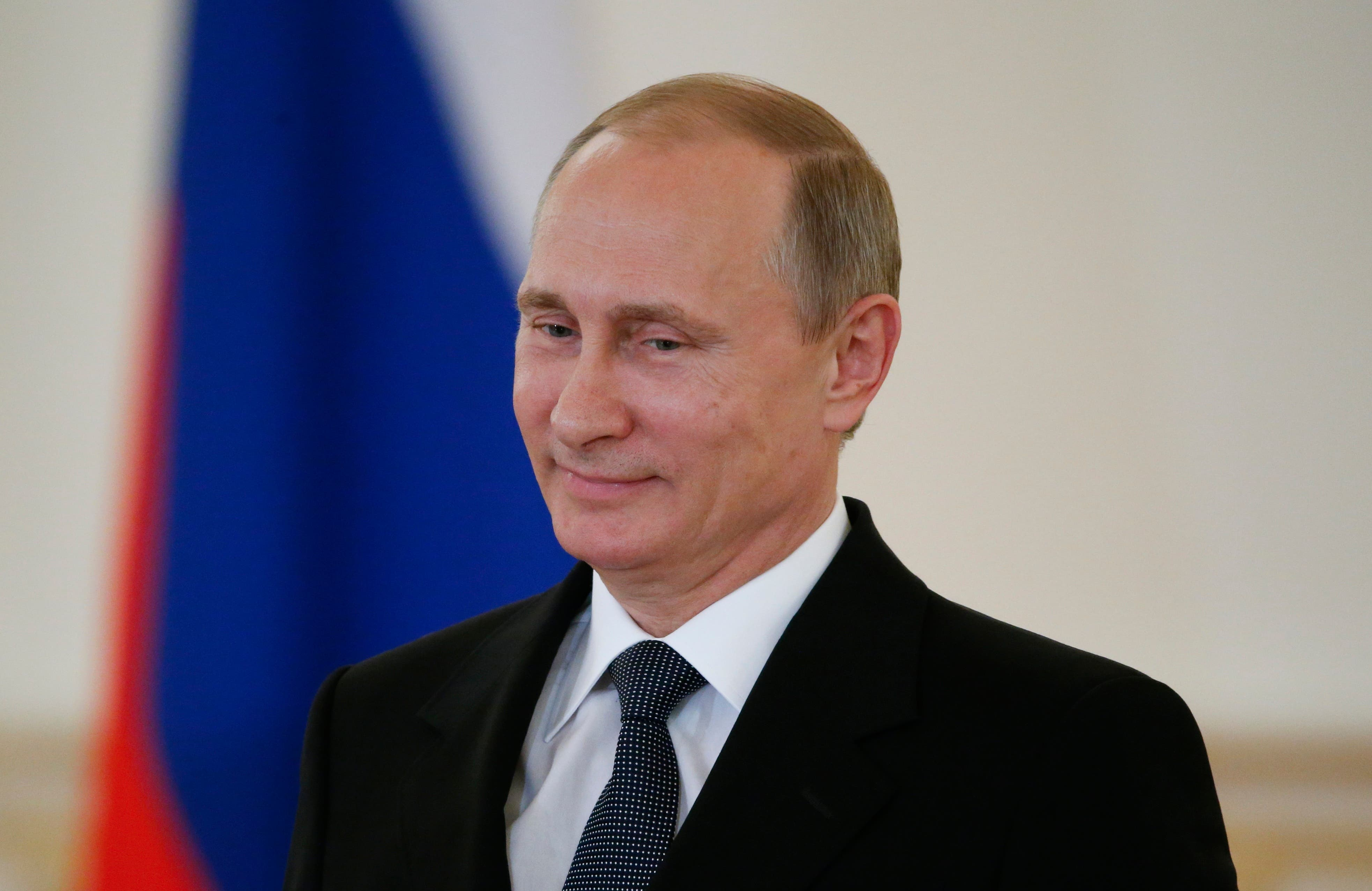Russian President Vladimir Putin attends a ceremony of presentation of credentials by foreign ambassadors in the Kremlin in Moscow, Russia, Thursday, May 28, 2015. President Vladimir Putin accused the United States of meddling in FIFA's affairs and hinted that it was part of an attempt to take the 2018 World Cup away from his country. (Sergei Karpukhin/Pool Photo via AP)