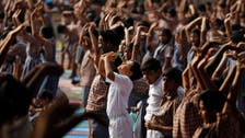 India tells bureaucrats to stretch with yoga-loving PM