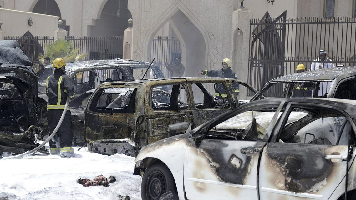 Firemen work at the site where a car exploded near a Shi'ite mosque in Saudi Arabia's Dammam May 29, 2015. Reuters