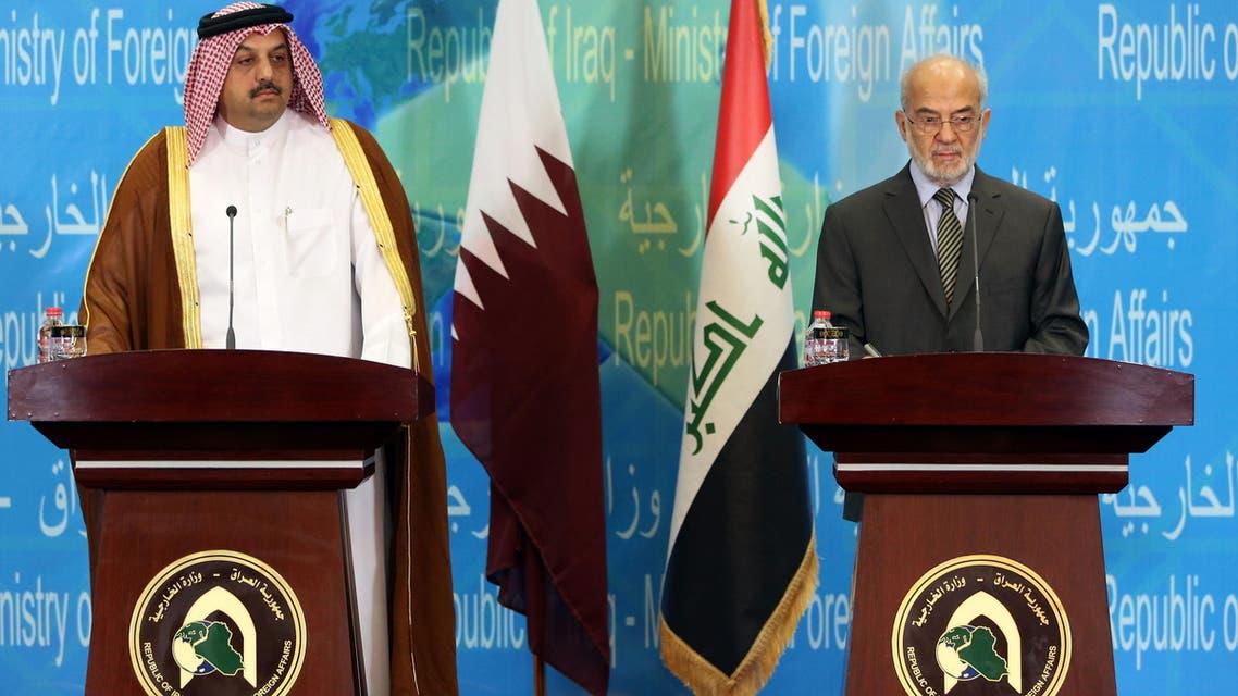 Qatari Foreign Minister Khalid bin Mohammed al-Attiyah, left, and his Iraqi counterpart Ibrahim al-Jaafari attend a press conference in Baghdad, Iraq, Friday, May 29, 2015. (AP)