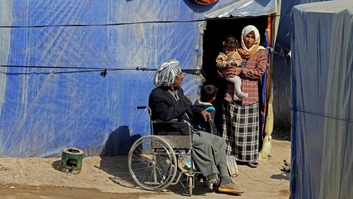 Iraqi refugees who fled from Tikrit and other towns after the advance of Islamic militants, settle at a camp for displaced Iraqis outside Baghdad, Iraq, Thursday, Feb. 19, 2015. (AP