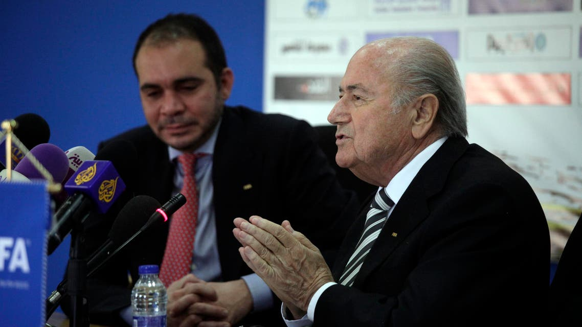 Sepp Blatter, right, the President of FIFA during his press conference with FIFA Vice President Jordan's Prince Ali Bin al-Hussein (L) in Amman, Jordan, Monday, May 26, 2014. (AP)