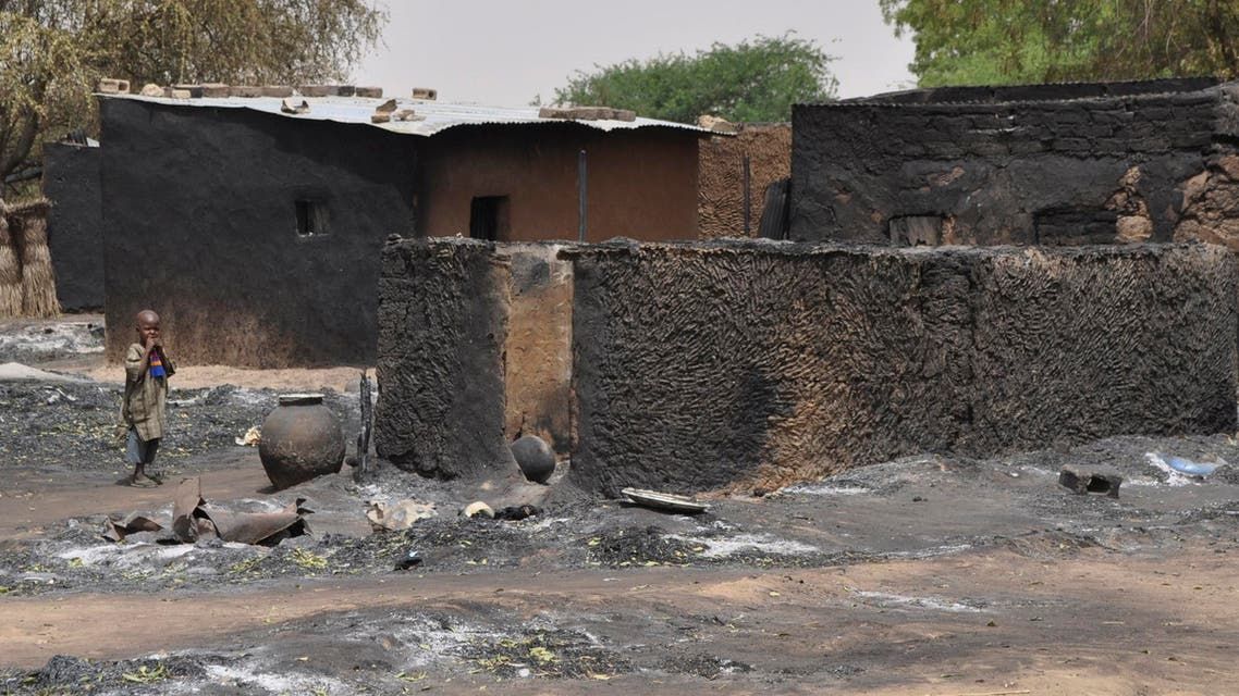 A child walks past burnt out houses following Sunday's attack by Boko Haram militants in Gubio, Nigeria, Tuesday, May 26, 2015. AP
