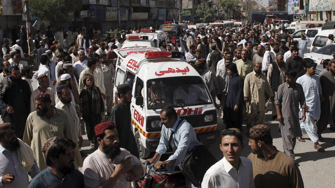 People escort ambulances, carrying victims of an attack on buses, to the hospital in Quetta, Pakistan, May 30, 2015. (Reuters)