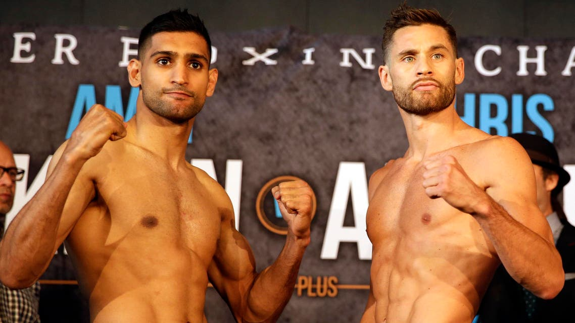 Boxers Amir Khan, left and Chris Algieri pose for photographers during their weigh-in, Thursday, May 28, 2015, in New York. AP